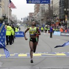 Caroline Rotich, of Kenya, breaks the tape to win the women's division of the Boston Marathon Monday, April 20, 2015 in Boston. (AP Photo/Elise Amendola)