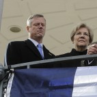 Valéry Freland, Consul General of France in Boston, center right, addresses a crowd as, from the left, Mass. Gov. Charlie Baker, U.S. Sen. Elizabeth Warren, D-Mass., and Boston Mayor Marty Walsh, right, listen during a vigil on the Boston Common, Sunday, Nov. 15, 2015, in Boston, held in sympathy for the people of Paris. Multiple attacks across the French capital on Friday night have left scores dead and hundreds injured. (AP Photo/Steven Senne)