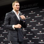 Football player Tom Brady is seen on stage at a TAG Heuer watch launch and brand ambassador announcement event at Spring Studios on Tuesday, Oct. 13, 2015, in New York. (Photo by Scott Roth/Invision/AP)
