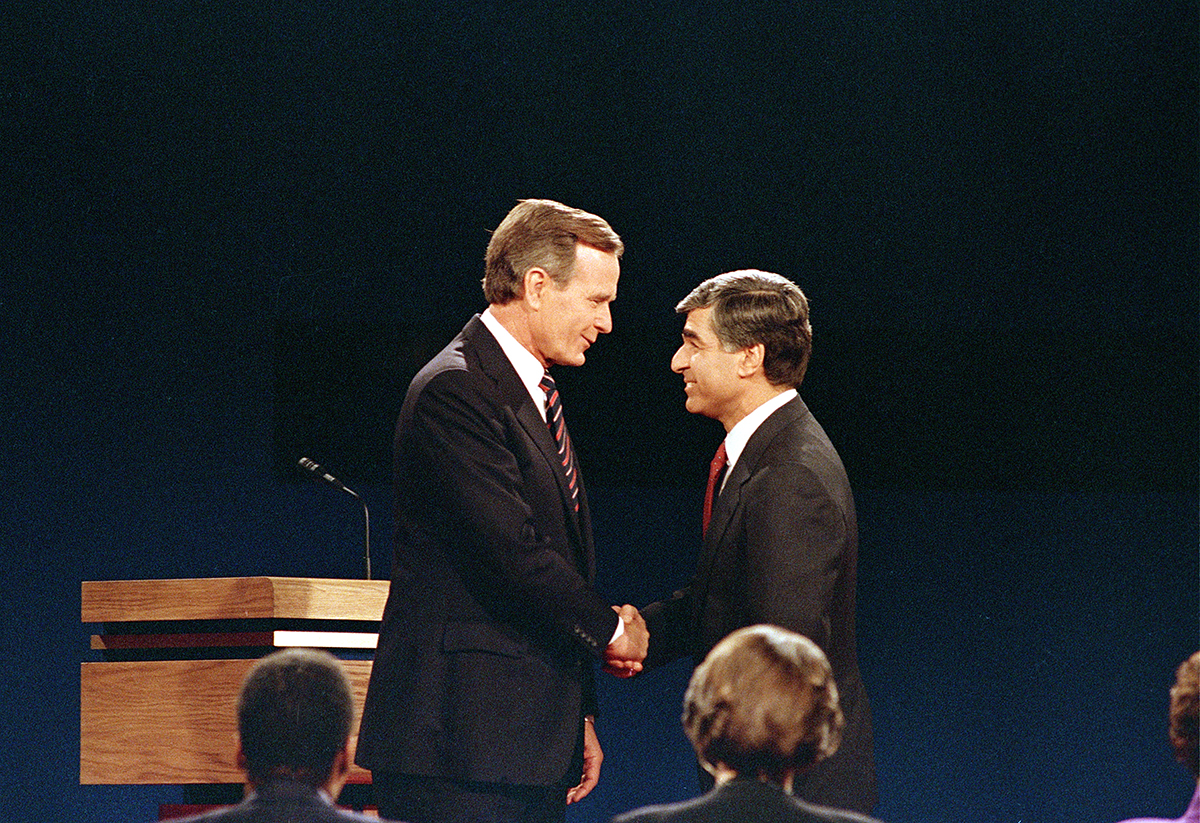 George H.W. Bush and Mike Dukakis at their second debate in 1988. AP Photo/Lennox McLendon