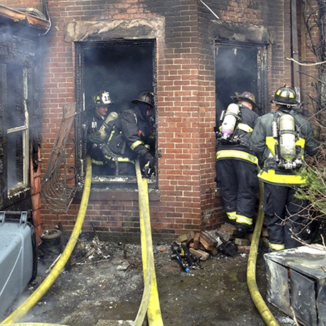 In this photo released by the Boston Fire Department via Twitter, firefighters battle a multi-alarm fire at a four-story brownstone in the Back Bay neighborhood near the Charles River Wednesday, March 26, 2014 in Boston.  (AP Photo/Boston Fire Department)