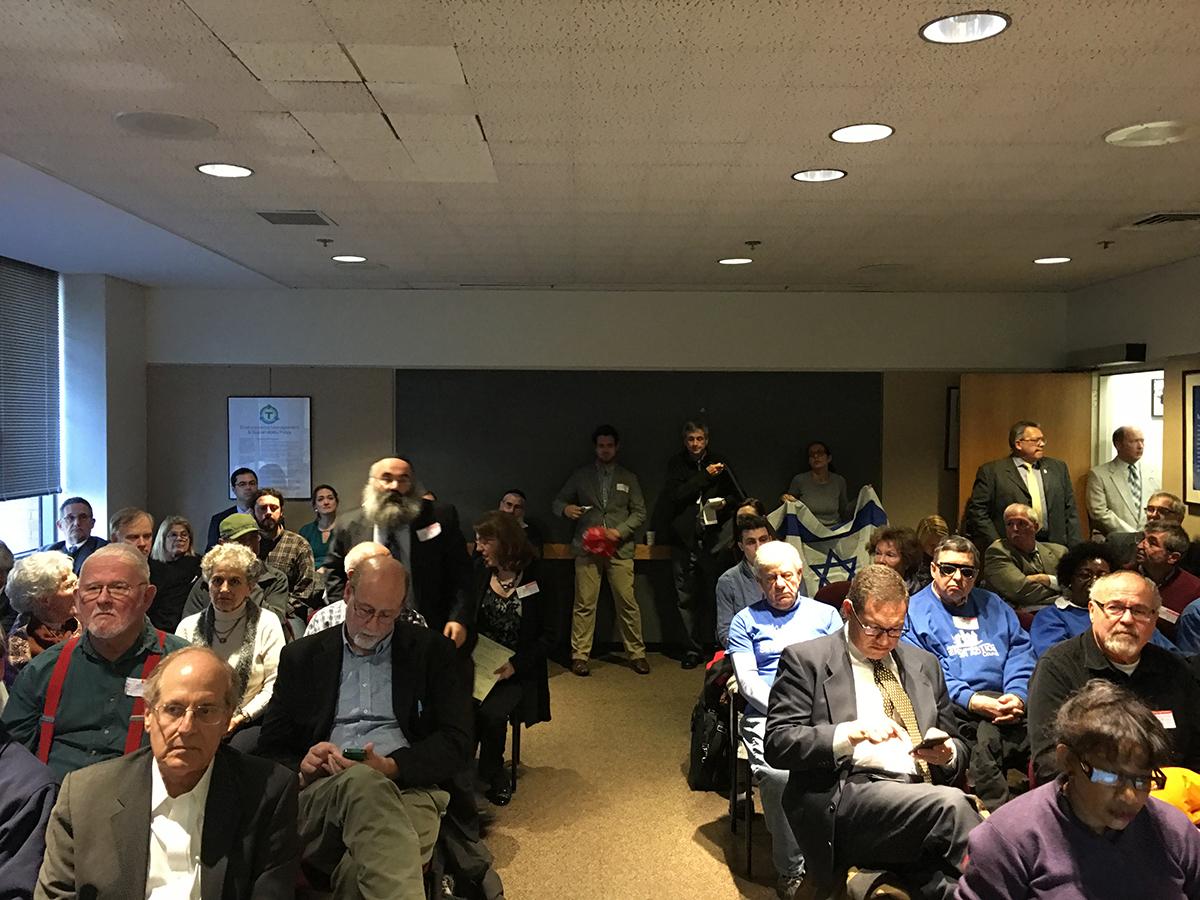 Palestinian and Israeli activists pack an MBTA Board meeting in November 2015.