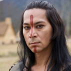 "Kalani Queypo as Squanto in National Geographic Channel's two-night movie event ""Saints & Strangers,"" premiering Nov. 22-23, 9/8c.  Squanto is a former captive and slave of English explorers, who has crossed the Atlantic four times and acts as a translator and negotiator between Massasoit and the people of the Plymouth Colony. 