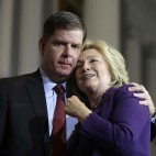 "Democratic presidential candidate Hillary Clinton, right, and Boston Mayor Marty Walsh, left, embrace on stage at the conclusion of a rally at Faneuil Hall, Sunday, Nov. 29, 2015, in Boston. The event was held to launch ""Hard Hats for Hillary,"" a coalition created to organize people in industries and labor to support Clinton's agenda. (AP Photo/Steven Senne)"