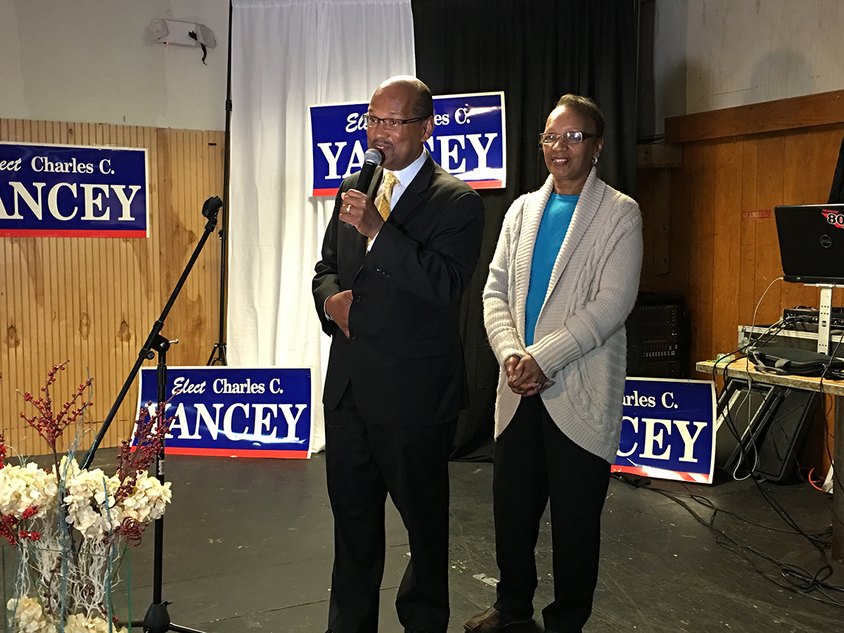 Charles and Marzetta Yancey speaking at his election night party. Photo by Garrett Quinn