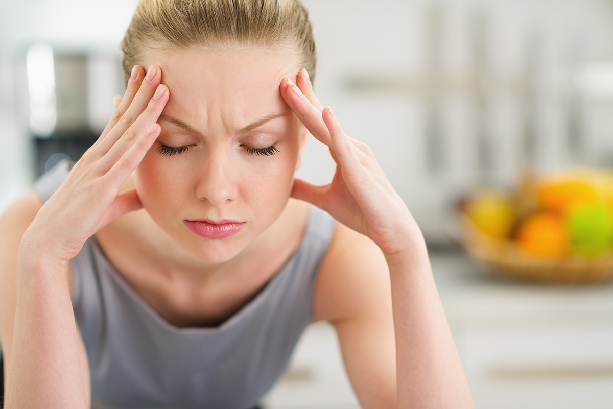Portrait of a stressed young housewife in a modern kitchen photo via Shutterstock