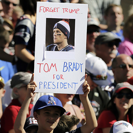 "FILE - In this Sept. 27, 2015, file photo, a New England Patriots fan holds a sign that refers to Patriots quarterback Tom Brady and Republican presidential candidate, businessman Donald Trump during an NFL football game between the Patriots and Jacksonville Jaguars in Foxborough, Mass. GQ magazine asked Brady, its 2015 Man of the Year, if he's ever considered making a play for the White House or at least for governor of Massachusetts. Brady said. ""There is a 0.000 chance of me ever wanting to do that."" (AP Photo/Charles Krupa, File)"