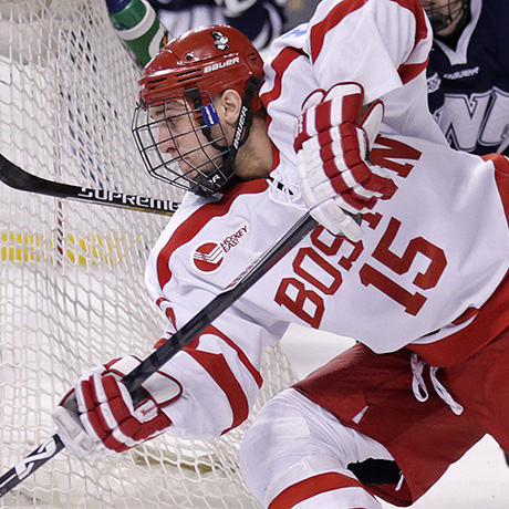 New Hampshire goalie Danny Tirone blocks the post as Boston University forward Nick Roberto (15) tries to poke the puck through during the second period of the Hockey East semifinals in Boston, Friday, March 20, 2015. (AP Photo/Charles Krupa)