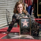 Amy Poehler poses on her new star on the Hollywood Walk of Fame on Thursday, Dec. 3, 2015, in Los Angeles. (Photo by Chris Pizzello/Invision/AP)