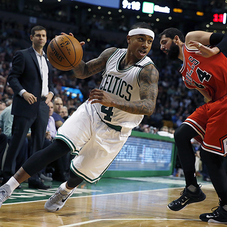 Boston Celtics' Isaiah Thomas (4) drives past Chicago Bulls' Nikola Mirotic (44) during the fourth quarter of an NBA basketball game in Boston, Wednesday, Dec. 9, 2015. The Celtics won 105-100. (AP Photo/Michael Dwyer)