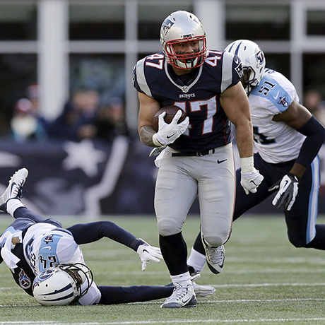 New England Patriots running back Joey Iosefa (47) runs from Tennessee Titans cornerback Coty Sensabaugh (24) and linebacker David Bass (51) in the first half of an NFL football game, Sunday, Dec. 20, 2015, in Foxborough, Mass. (AP Photo/Charles Krupa)