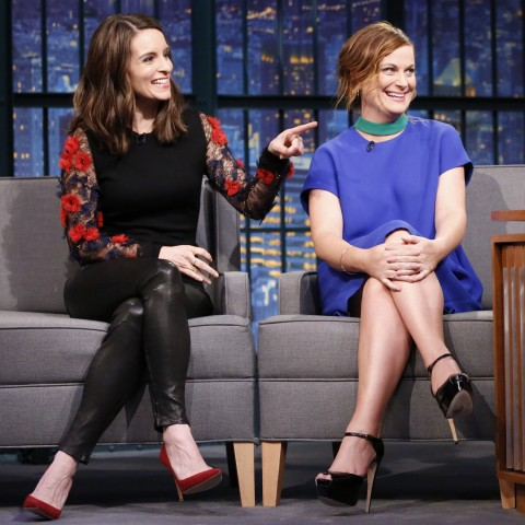 LATE NIGHT WITH SETH MEYERS -- Episode 304 -- Pictured: (l-r) Tina Fey and Amy Poehler during an interview with host Seth Meyers on December 17, 2015 -- (Photo by: Lloyd Bishop/NBC)