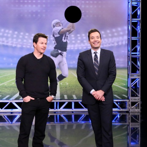 THE TONIGHT SHOW STARRING JIMMY FALLON -- Episode 0388 -- Pictured: (l-r) Actor Mark Wahlberg and host Jimmy Fallon play Random Object Football Toss on December 15, 2015 -- (Photo by: Douglas Gorenstein/NBC)