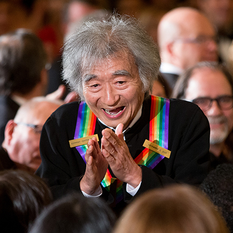 2015 Kennedy Center Honors Honoree conductor Seiji Ozawa stops to greet a young child in the audience as he arrives for a reception for him and the other honorees in the East Room of the White House, Sunday, Dec. 6, 2015, in Washington. The 2015 Kennedy Center Honors Honorees are singer-songwriter Carole King, filmmaker George Lucas, actress and singer Rita Moreno, conductor Seiji Ozawa, and actress Cicely Tyson. (AP Photo/Andrew Harnik)