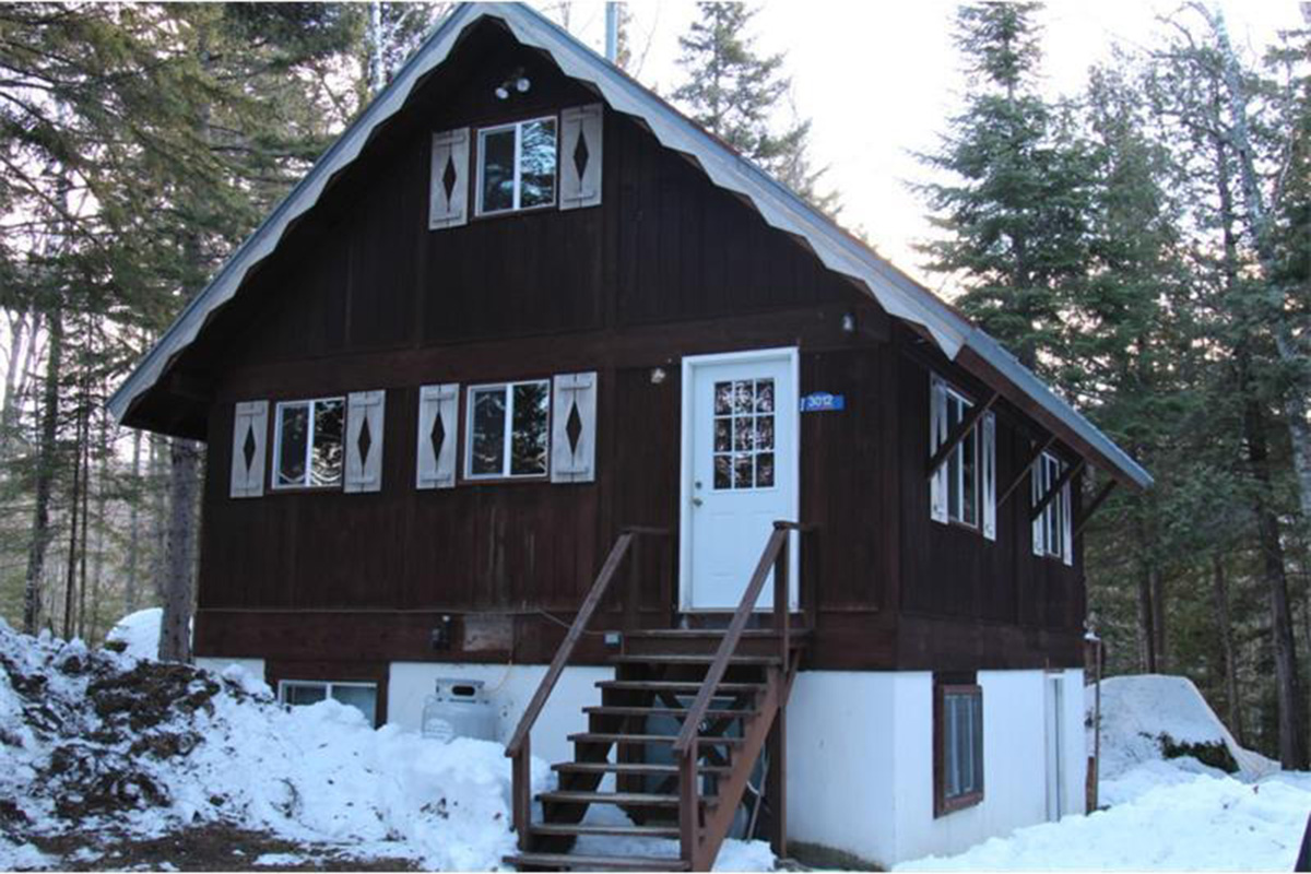 Six new england ski houses for sale boston magazine for Cost of building a house in vermont