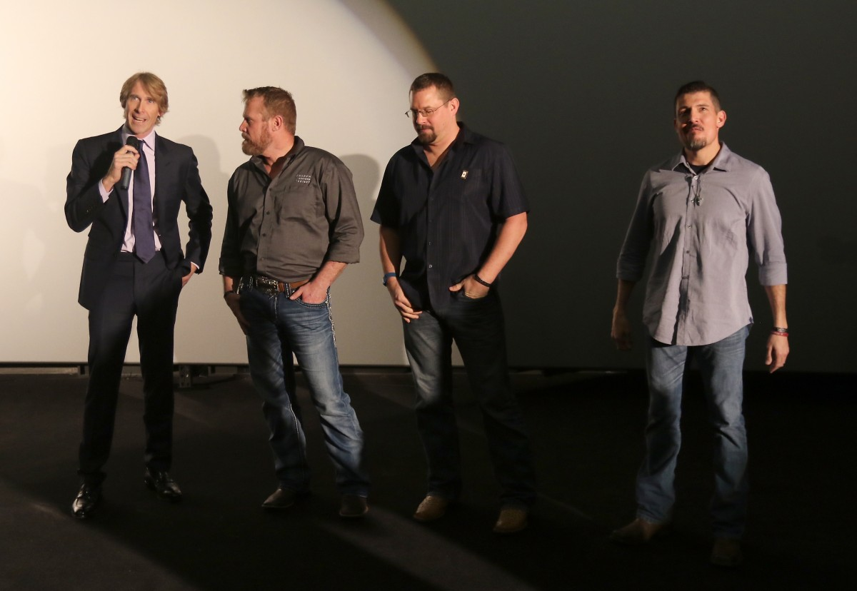 """AVENTURA, FL - JANUARY 07: Director Michael Bay, Co-author of """"13 Hours"""" Mark """"Oz"""" Geist, Co-author of """"13 Hours"""" John """"Tig"""" Tiegen and Kris """"Tanto"""" Paronto attends the Miami Fan Screening of the Pramount Pictures film """"13 Hours: The Secret Soldiers of Benghazi"""" at the AMC Aventura on January 7, 2016 in Miami, Florida. (Photo by John Parra/Getty Images for Paramount Pictures) *** Local Caption *** Kris Paronto; Michael Bay; John Tiegen; Kris Paronto"""