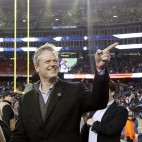 Massachusetts Gov. Charlie Baker walks on the sideline at Gillette Stadium before the NFL football AFC Championship game between the New England Patriots and Indianapolis Colts Sunday, Jan. 18, 2015, in Foxborough, Mass. (AP Photo/Elise Amendola)