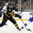 Boston Bruins' Patrice Bergeron (37) takes a shot in front of Montreal Canadiens' P.K. Subban (76) during the second period of the NHL Winter Classic hockey game at Gillette Stadium in Foxborough, Mass., Friday, Jan. 1, 2016. The Canadiens won 5-1. (AP Photo/Michael Dwyer)