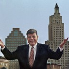"FILE - In this October 1998 file photo, Mayor Vincent ""Buddy"" Cianci Jr., poses along in front of the city's skyline in Providence, R.I. Cianci, who served a total of 21 years as mayor, was twice driven from office due to felony convictions. He is making another comeback bid in the Nov. 4, 2014 election. (AP Photo/Matt York, File)"