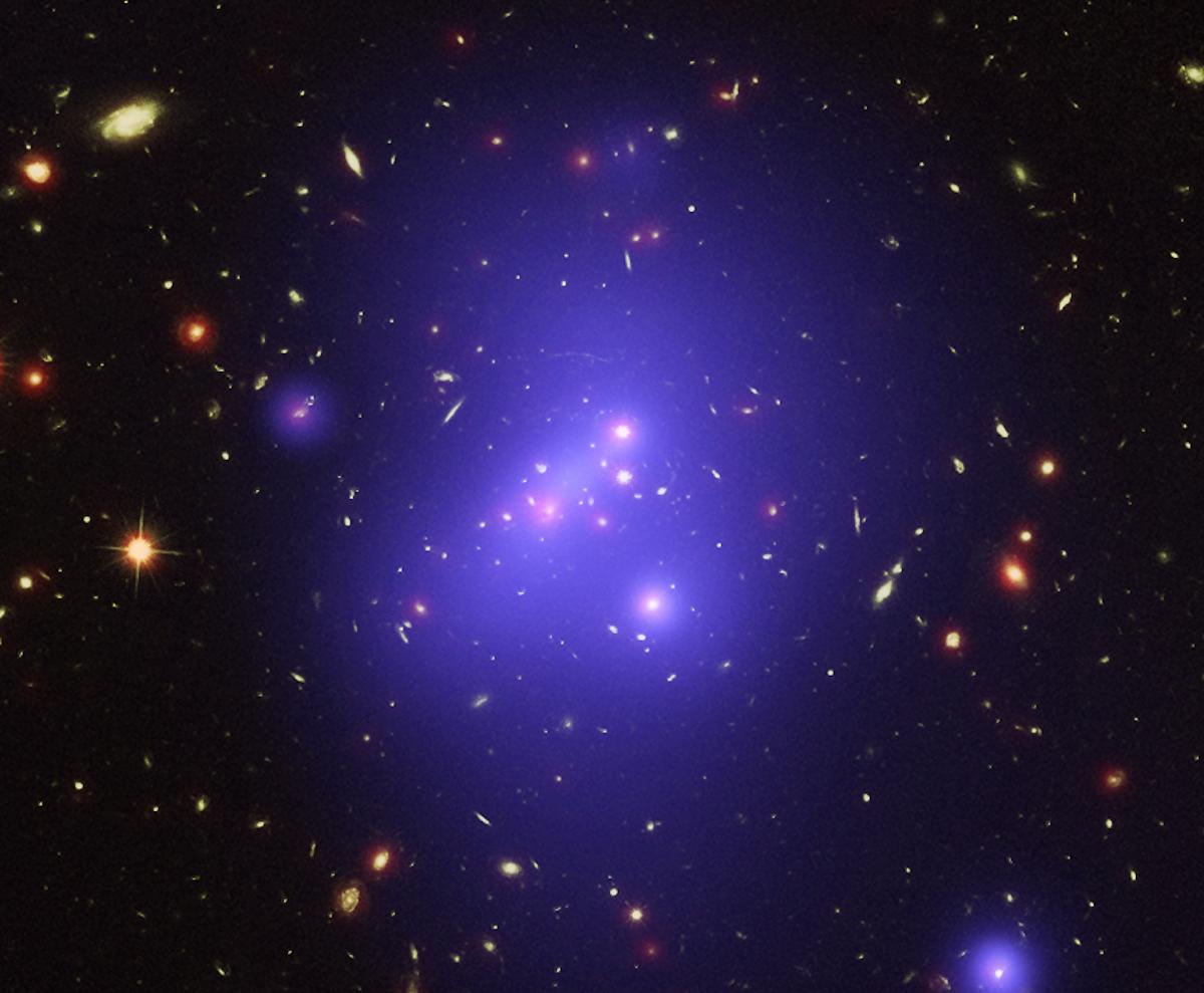 The galaxy cluster shines bright from 10 billion-light years away. Photo via NASA.