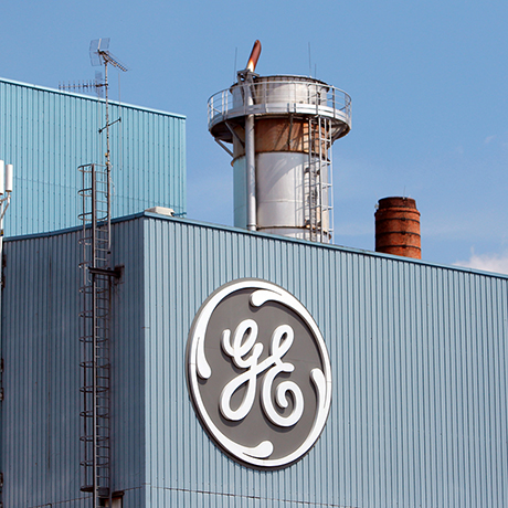 FILE - This June 24, 2014 file photo shows the General Electric plant in Belfort, eastern France. General Electric Co. is cutting up to 6,500 jobs in Europe after buying a big chunk of France's Alstom, raising questions about GE's pledges to create rather than destroy jobs. (AP Photo/Thibault Camus, File)