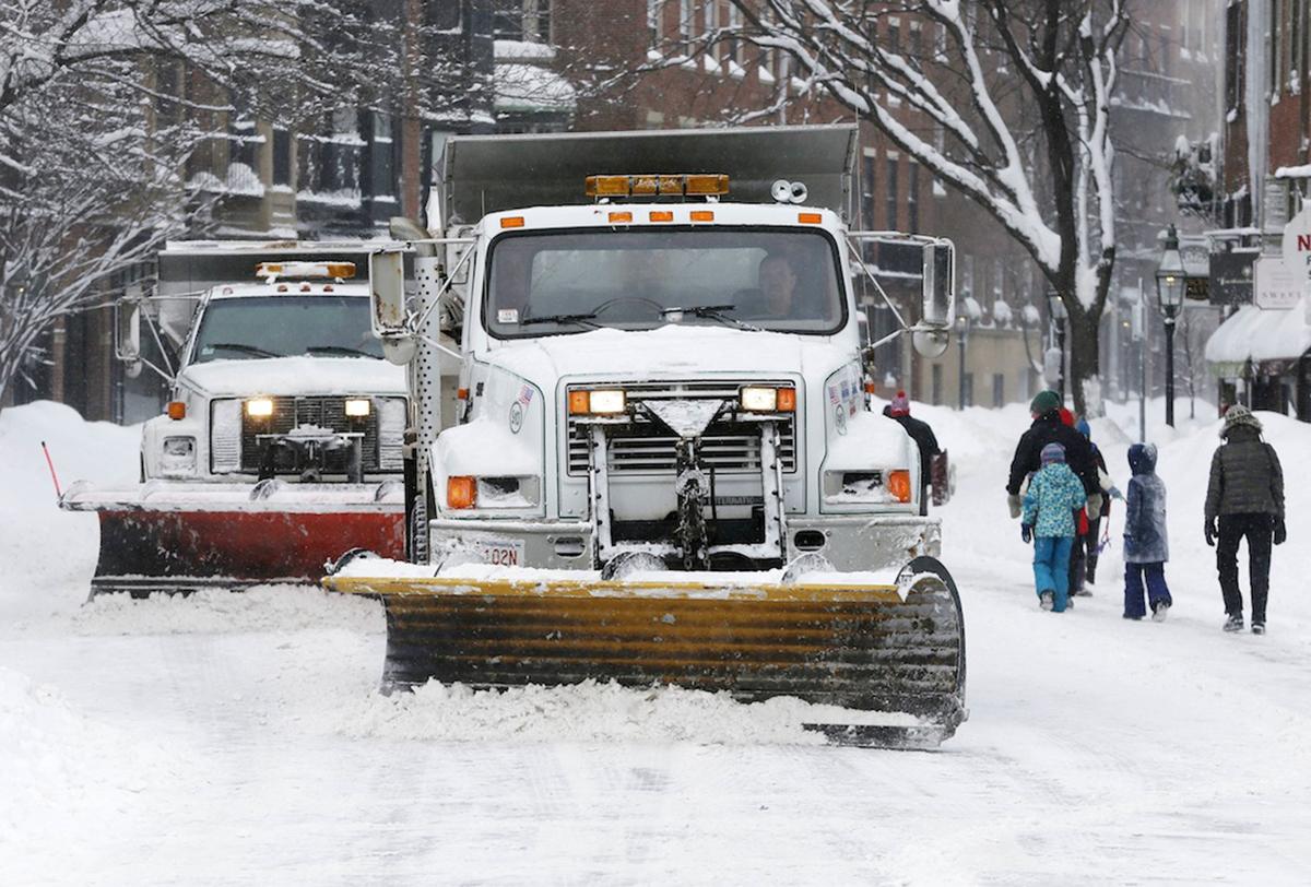 Plows clear Charles Street in Boston, Sunday, Feb. 15, 2015. (AP Photo/Michael Dwyer)