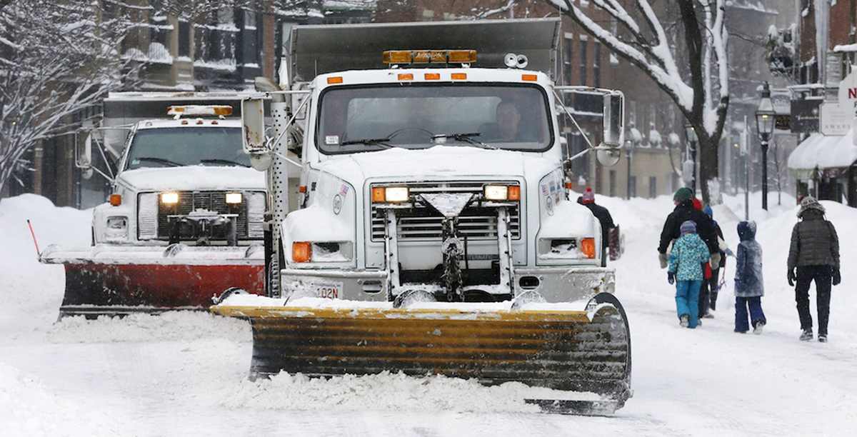 Plows clear Charles Street in Boston.