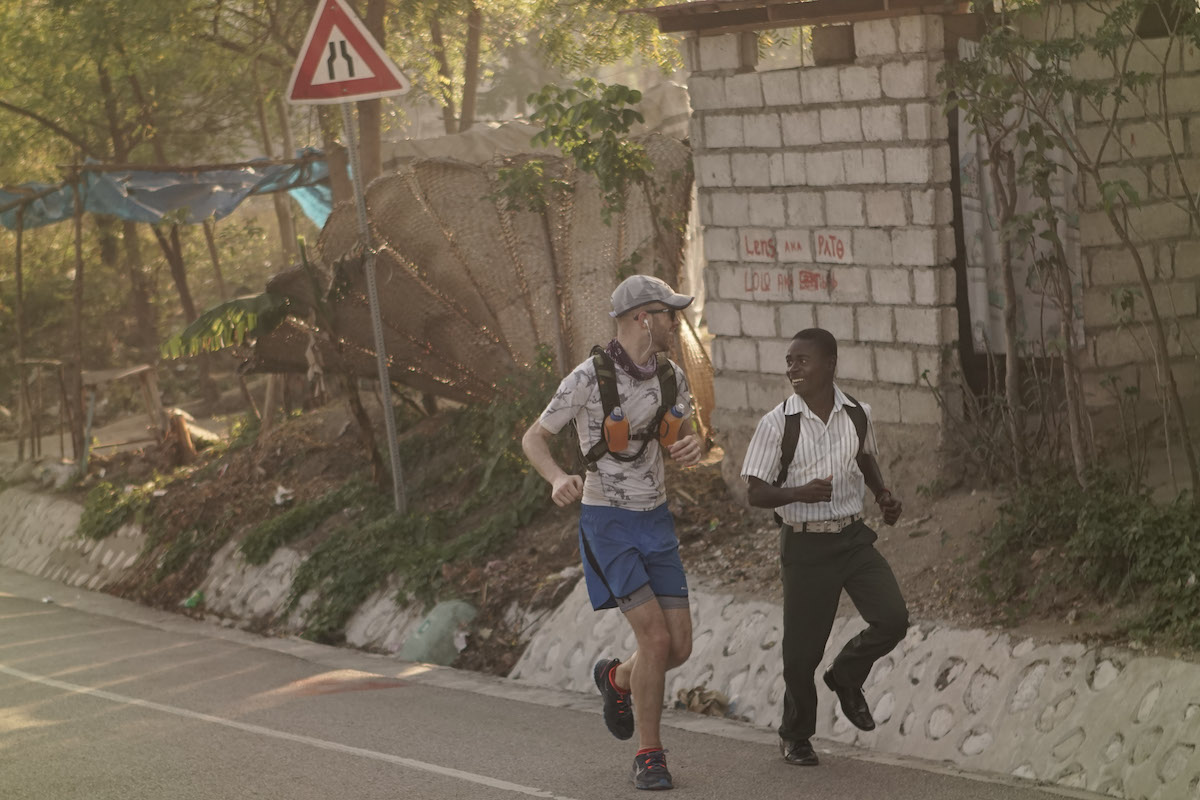 Owen Mattison, left, was joined by an young man for part of last year's run across Haiti.
