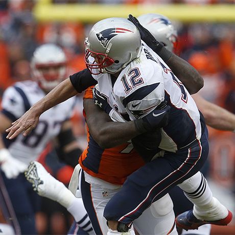 New England Patriots quarterback Tom Brady is tackled by Denver Broncos defensive end Malik Jackson after throwing a pass during the first half the NFL football AFC Championship game between the Denver Broncos and the New England Patriots, Sunday, Jan. 24, 2016, in Denver. (AP Photo/Joe Mahoney)