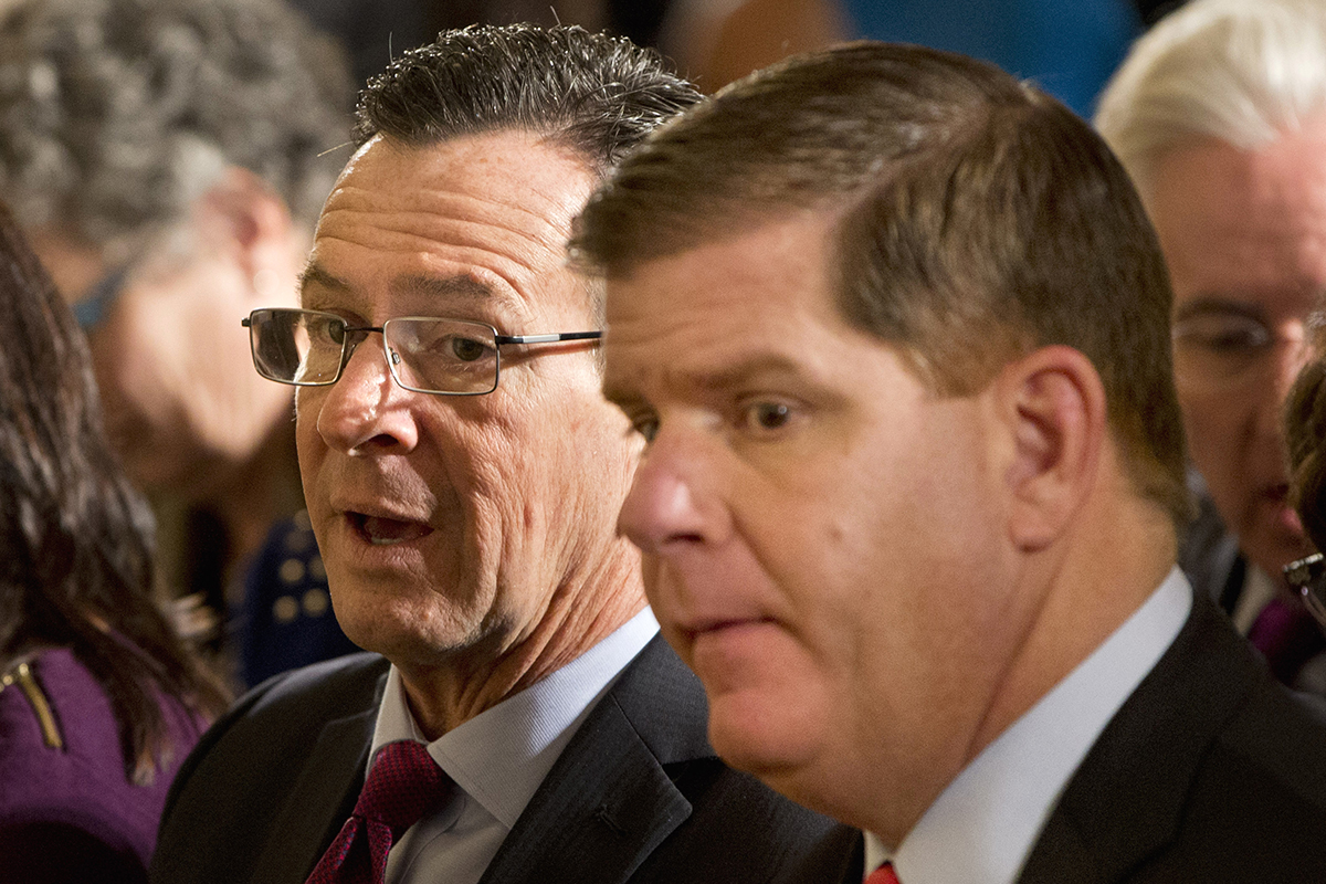 Connecticut Gov. Dannel Malloy and Boston Mayor Marty Walsh sit in the East Room of the White House before President Obama spoke about his executive order on gun control. AP Photo/Jacquelyn Martin