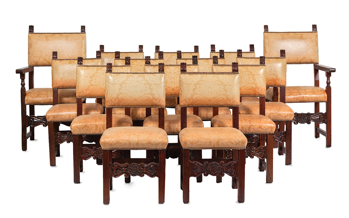 A set of fourteen Spanish Baroque-style walnut dining chairs
