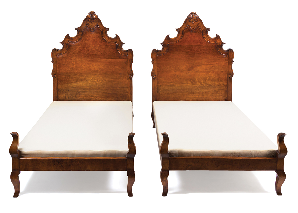 A pair of Venetian-style twin walnut beds