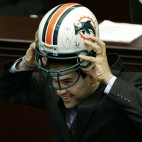 House Speaker Marco Rubio, R-Coral Gables, tries on a Miami Dolphins football helment given to him by colleagues during ceremonies honoring him as the retiring House Speaker, Friday, May 2, 2008, in Tallahassee, Fla.(AP Photo/Phil Coale)