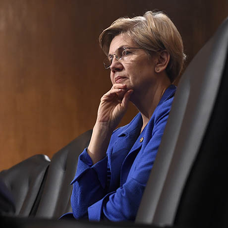 Senate Banking Committee member Sen. Elizabeth Warren, D-Mass. listens as Federal Reserve Chair Janet Yellen testifies before the committee on Capitol Hill in Washington, Thursday, July 16, 2015. (AP Photo/Susan Walsh)