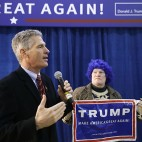 Former Massachusetts Sen. Scott Brown welcome attendees to a Republican presidential candidate, Donald Trump campaign stop, Saturday, Jan. 16, 2016, in Portsmouth, N.H. (AP Photo/Matt Rourke)