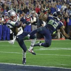 FILE - In this Feb. 1, 2015, file photo, New England Patriots cornerback Malcolm Butler (21) intercepts a pass intended for Seattle Seahawks wide receiver Ricardo Lockette (83) during the second half of the Super Bowl NFL football game, in Glendale, Ariz. The Seahawks' loss in the game to the late interception was among the top stories in the state in 2015. (AP Photo/Kathy Willens, File)