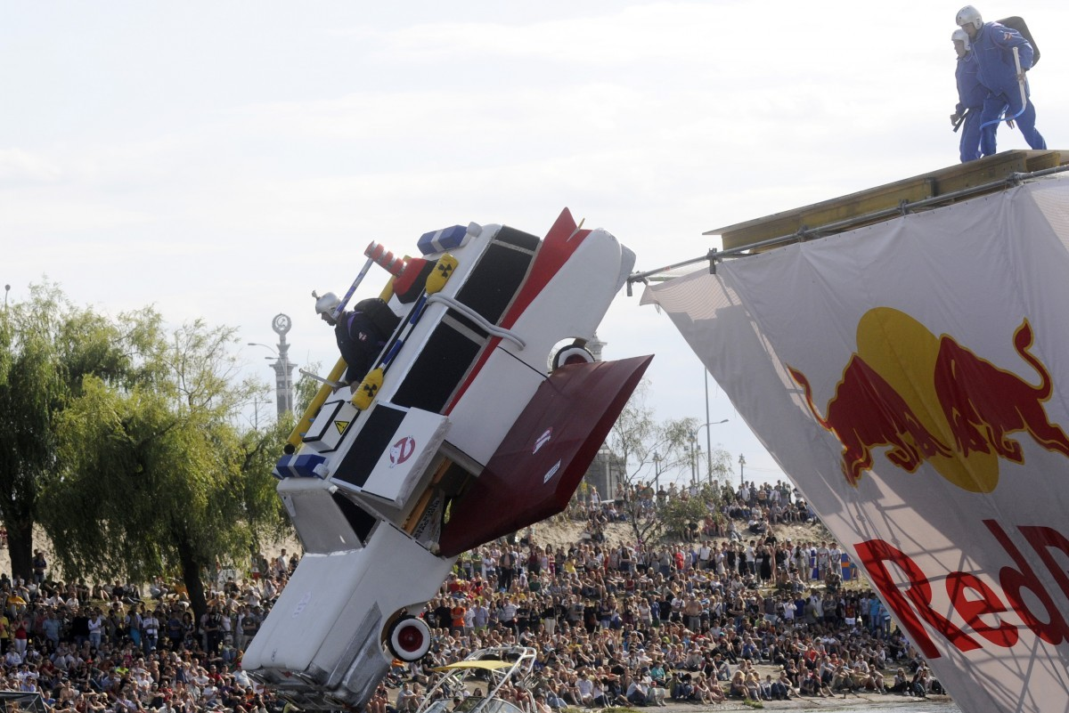 The Classmates flying team falls into the water whilst taking part in the Red Bull Flugtag 2010 competition in Kiev, Ukraine, Saturday, June 19, 2010. (AP Photo/Sergei Chuzavkov)