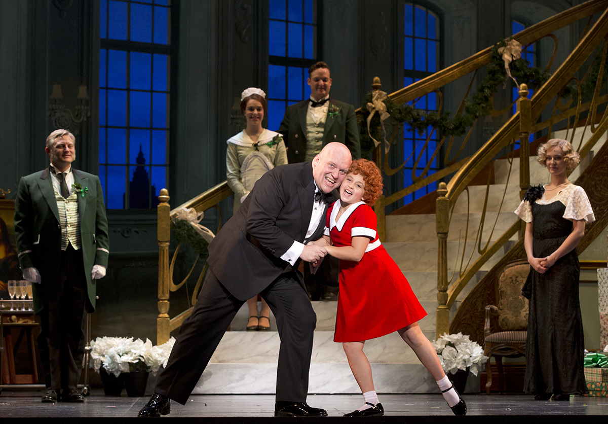 Annie and Daddy Warbucks dance onstage
