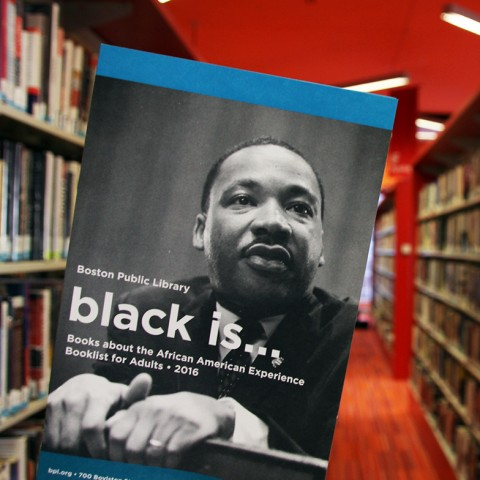 """A """"Black Is..."""" booklist brochure in the library."""