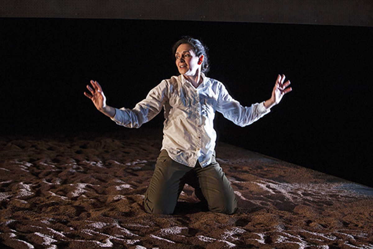 Marissa Chibas kneels onstage