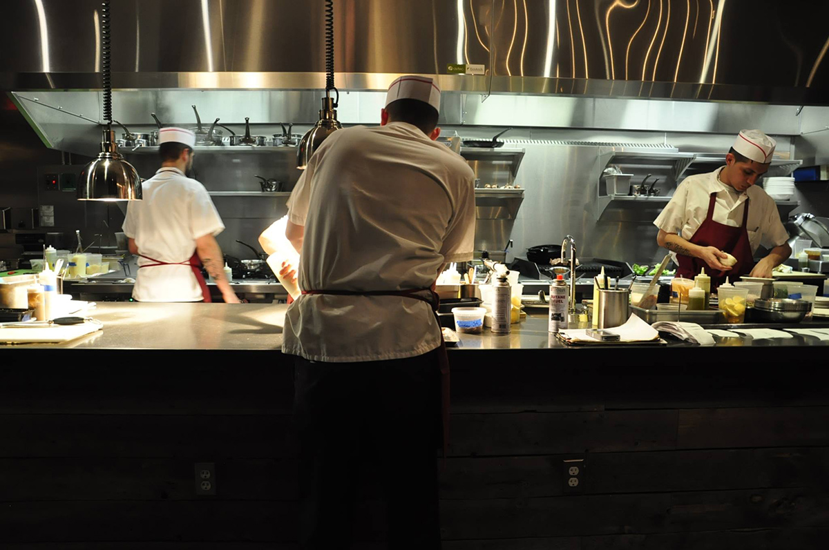 Chefs on the line at Ribelle. / Photo via Facebook