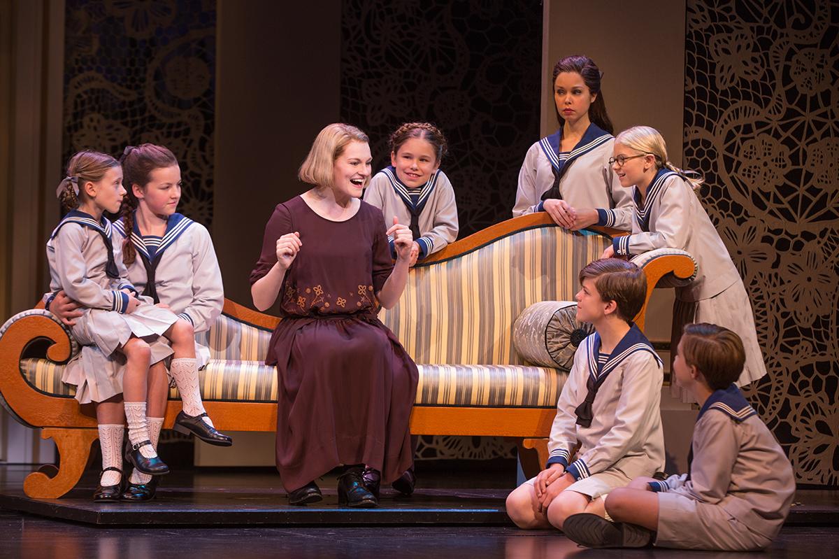 he Von Trapp children listen as Maria sings