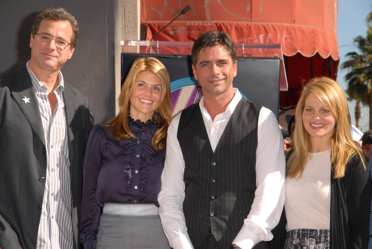 From left: Bob Saget, Lori Loughlin, John Stamos, and Candace Cameron-Bure Photo by s_bukley / Shutterstock.com
