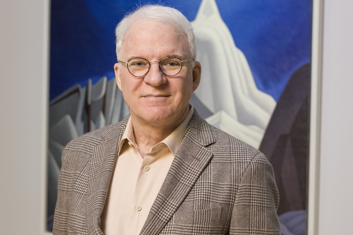 Guest curator Steve Martin during the installation of the exhibition The Idea of North: The Paintings of Lawren Harris at the Museum of Fine Arts, Boston.March 8, 2016 Saundra and William H. Lane Galleries * Photograph © Museum of Fine Arts, Boston