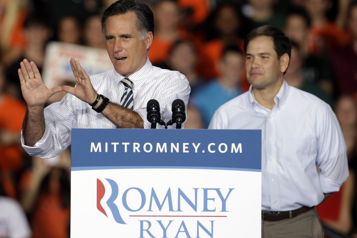 """Republican presidential candidate, former Massachusetts Gov. Mitt Romney, accompanied by Sen. Marco Rubio, R-Fla., makes """"The U"""" hand sign during a campaign event at the University of Miami, Wednesday, Oct. 31, 2012, in Coral Gables, Fla. (AP Photo/Lynne Sladky)"""