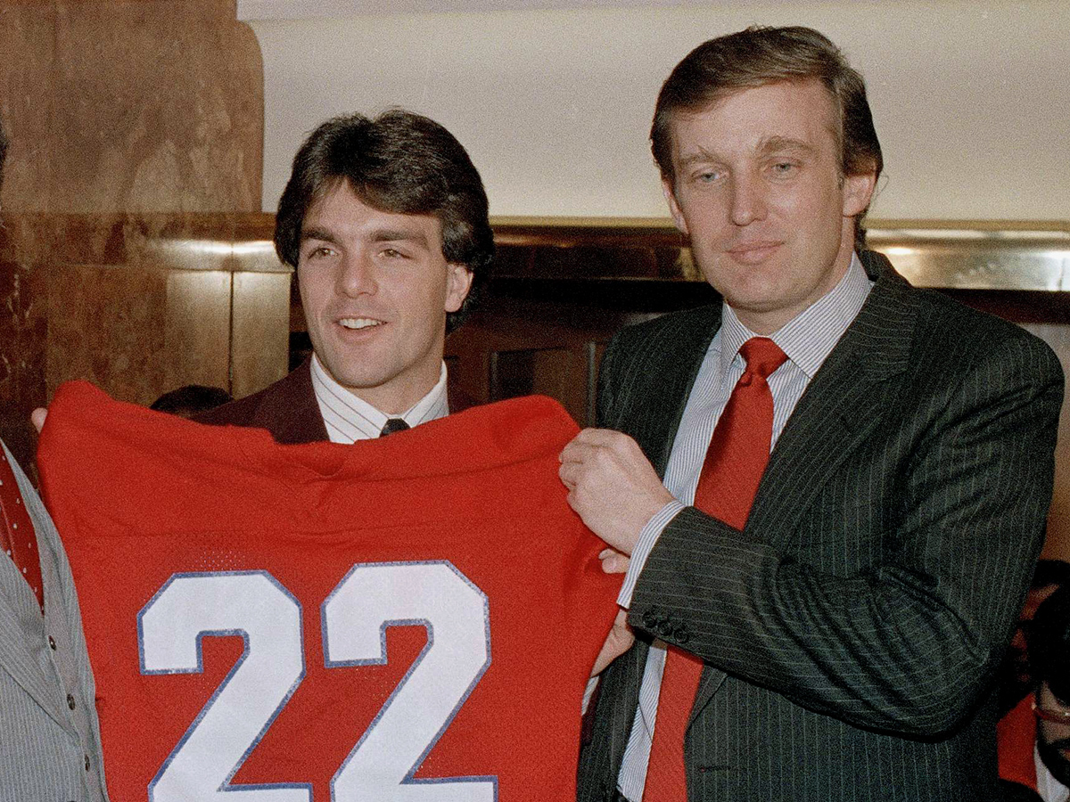 Trump and newly signed N.J. Generals QB Doug Flutie. Photo via AP