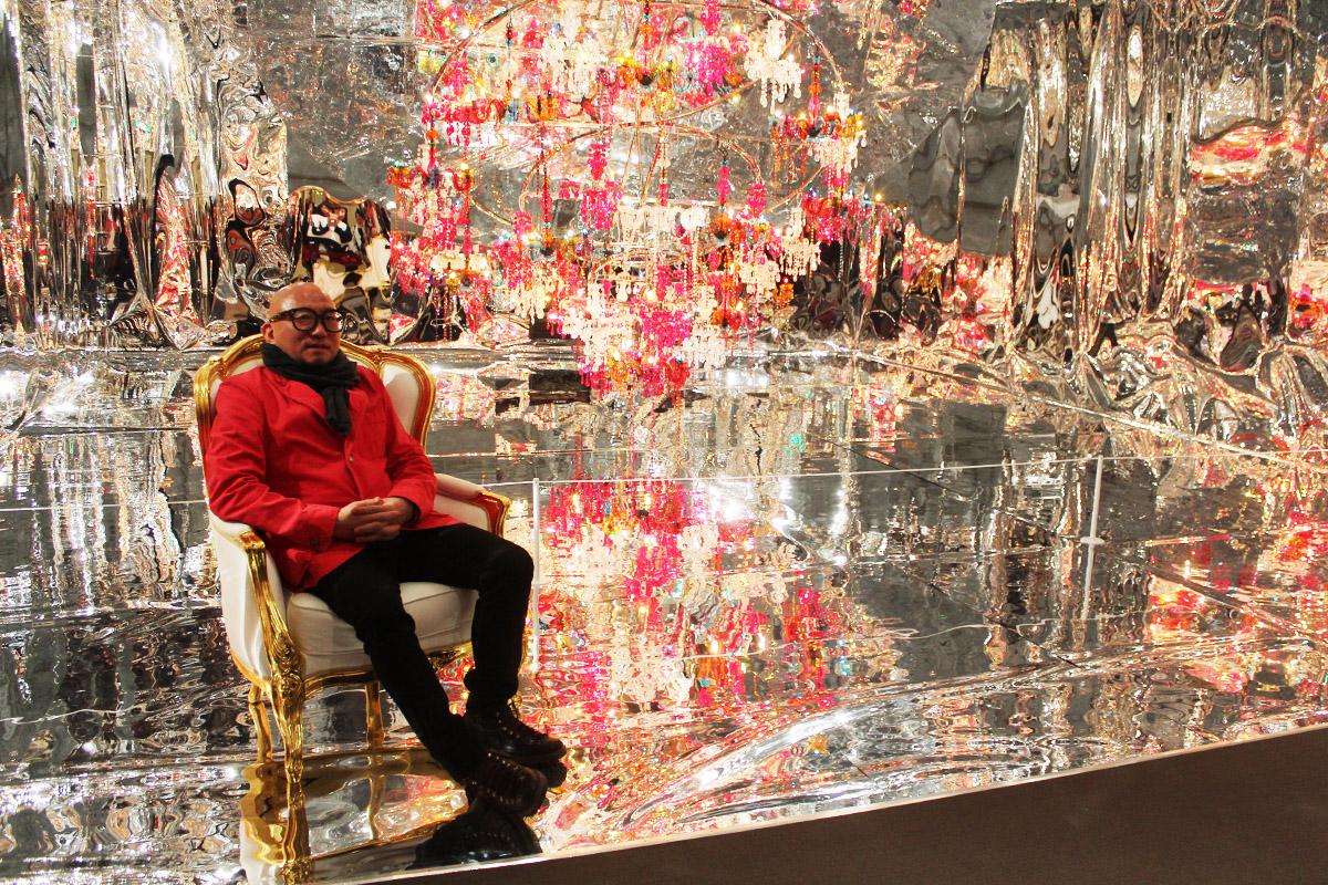 Choi Jeong Hwa sits in his piece 'Chaosmos Mandala.' MFA Megacities Asia.