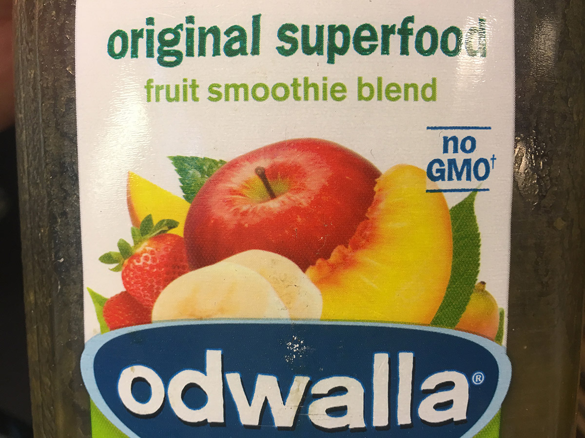 A GMO label in action. Photo by Garrett Quinn