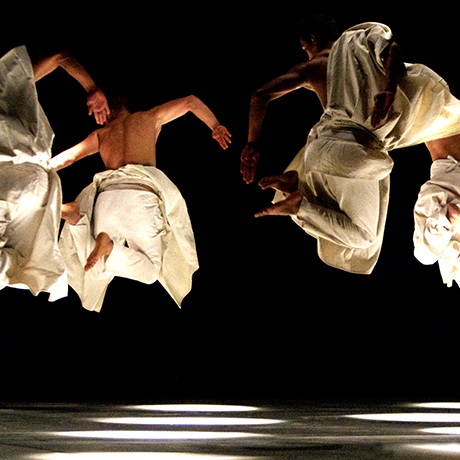 Herve Koub dance troupe leaping on stage