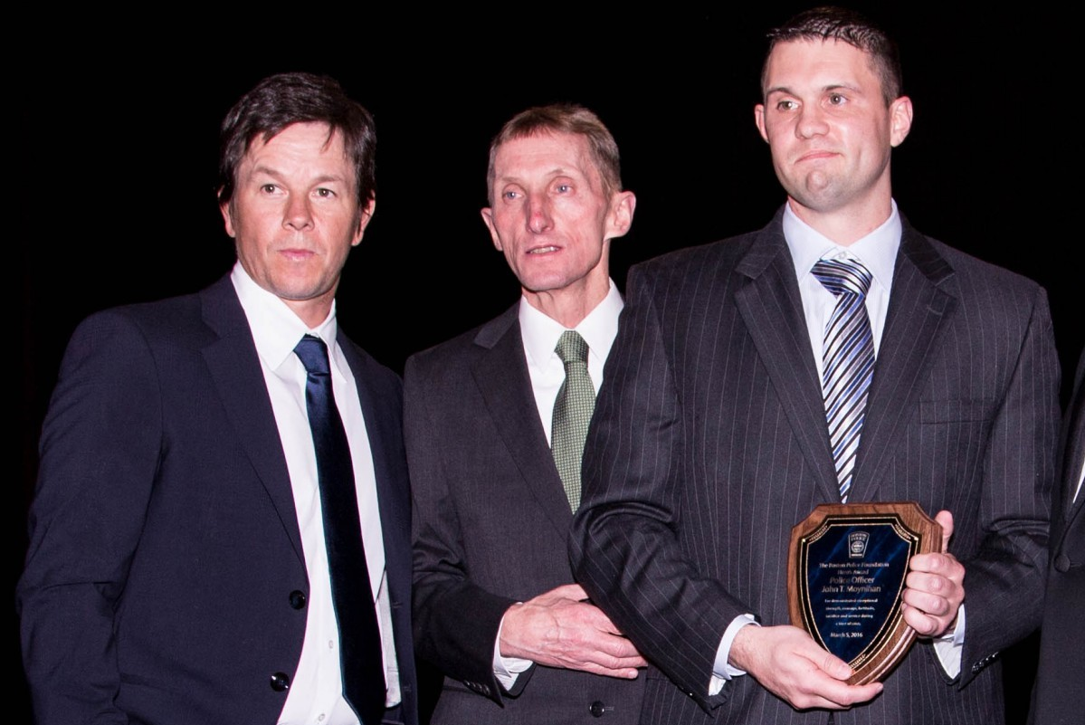 March 5, 2016, BOSTON - (From left) Mark Wahlberg, Boston Police Commissioner William Evans, and Boston Police Officer John Moynihan appear at the 3rd Annual Boston Police Foundation Gala Saturday night at the Westin Boston Waterfront Hotel. Wahlberg presented the Hero's Award to Boston Police Officer John Moynihan who was shot last year. Photo by Alexandra Wimley